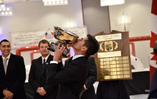 Image of MAC winner kissing trophy